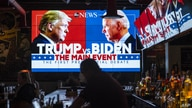 WASHINGTON, DC - SEPTEMBER 29: Television screens airing the first presidential debate are seen at Walters Sports Bar on…