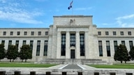 (FILES) In this file photo taken on July 01, 2020, the Federal Reserve Board building in Washington,DC. - The US Federal…