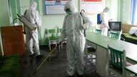 Offices at the Phyongchon District People's Hospital are disinfected Wednesday, April 1, 2020, in Pyongyang, North Korea. The…