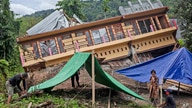 Residents build tents outside their house badly damaged by earthquake in Mamuju, West Sulawesi, Indonesia, Tuesday, Jan. 19,…
