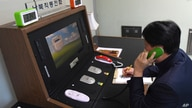In this photo provided by South Korea Unification Ministry, a South Korean government official communicates with a North Korean…