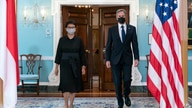 Secretary of State Antony Blinken, right, and Indonesian Foreign Minister Retno Marsudi walk to meet members of the media after…