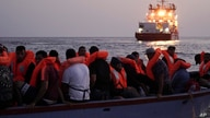 Migrants on an overcrowded wooden boat wait to be rescued in the Mediterranean Sea, Thursday, Sept. 19, 2019. The Ocean Viking,…