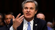 FILE PHOTO: FBI Director Christopher Wray testifies before a Senate Homeland Security and Governmental Affairs Committee