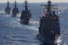 FILE - In this Dec. 10, 2010 file photo, USS Cowpens (CG63), right, leads Japan Maritime Self Defense Force's vessels during …