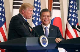 FILE - President Donald Trump, left, speaks as South Korean President Moon Jae-in looks on during a joint news conference at the Blue House in Seoul, South Korea, Nov. 7, 2017.