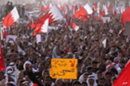 Tens of thousands of Bahraini anti-government protesters jam the main highway into Manama, Bahrain, on Tuesday, Feb. 22, 2011 for a massive march to the Pearl roundabout. Bahrain's king ordered the release of some political prisoners Tuesday, conceding to