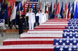 Vice President Mike Pence, left, Commander of U.S. Indo-Pacific Command Adm. Phil Davidson, center, and Rear Adm. Jon Kreitz, deputy director of the POW/MIA Accounting Agency, attend at a ceremony marking the arrival of the remains believed to be of Am...