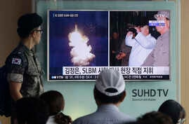 FILE - A South Korean army soldier watches a TV news program showing images published in North Korea's Rodong Sinmun newspaper of North Korea's ballistic missile launch and North Korean leader Kim Jong-un, at Seoul Railway station in Seoul, South Korea...