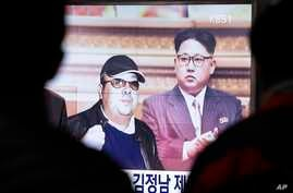 FILE - A TV screen shows pictures of North Korean leader Kim Jong Un and his older brother Kim Jong Nam, left, at the Seoul Railway Station in Seoul, South Korea, Feb. 14, 2017.
