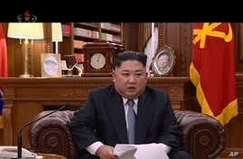 In this undated image from video distributed on Jan. 1, 2019, by North Korean broadcaster KRT, North Korean leader Kim Jong Un delivers a speech in North Korea.