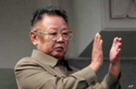FILE - In this Oct. 10, 2011 file photo, North Korean leader Kim Jong Il applauds after the biggest parade ever to mark the 65th anniversary of the communist nation's ruling Workers' Party in Pyongyang, North Korea when he and his son, heir apparent Kim J