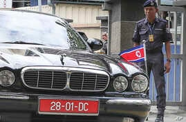 FILE - The car of ambassador of North Korea to Malaysia leaves the forensic department at the hospital in Kuala Lumpur, Malaysia, Feb. 15, 2017.