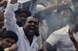 Indian students demanding the creation of a new Telangana state shout slogans as they burn an effigy of the government during a protest in Hyderabad, India, Tuesday, Feb.22, 2011. (AP Photo/Mahesh Kumar A.)