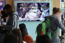 A TV screen shows a satellite image of the Punggye-ri nuclear test site in North Korea during a news program at the Seoul Railway Station in Seoul, South Korea, May 13, 2018.