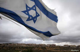 An Israeli flag flies on a hill near the West Bank Jewish settlement of Elazar, near Bethlehem March 17, 2013. U.S. President Barack Obama is due to make his first official visit to Israel and the Palestinian Territories this week, looking to improve ties
