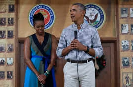 President Barack Obama, joined by first lady Michelle Obama, speaks during an event to thank service members and their families at Marine Corps Base Hawaii, in Kaneohe Bay, Hawaii, Dec. 25, 2016.