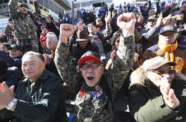 A South Korean Vietnam War veteran shouts during a rally to denounce the United States' demand for raising the defense costs for stationing U.S. troops in South Korea, near the U.S. embassy in Seoul, South Korea, Nov. 20, 2019.