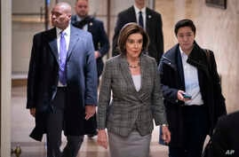 Speaker of the House Nancy Pelosi, D-Calif., arrives as defense arguments by the Republicans resume in the Senate impeachment…