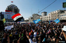 Iraqi demonstrators and university students gather to express their rejection of the newly appointed Prime Minister of Iraq,…