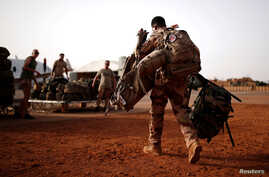 FILE PHOTO: A French soldier leaves with his backpack in Gao, Mali, August 1, 2019. Picture taken August 1, 2019. REUTERS…