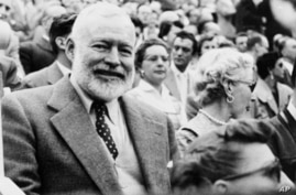 U.S. author Ernest Hemingway and his wife Mary attend a bullfight in Madrid, Spain, Oct. 9, 1956.  (AP Photo)