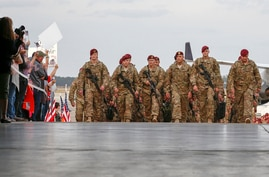 Paratroopers with the 1st Brigade Combat Team, 82nd Airborne Division, march up the ramp as they return home from Afghanistan…