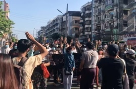 People protest in Hlaing Township, Yangon, Myanmar May 2, 2021, in this still image from a video obtained by Reuters.  THIS…