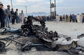 People stand at the site of a blast in Kabul, Afghanistan May 8, 2021.  REUTERS/Stringer   NO RESALES. NO ARCHIVES