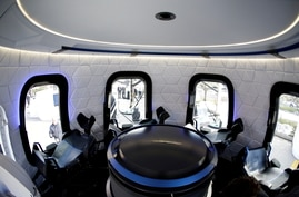 FILE PHOTO: An interior view of the Blue Origin Crew Capsule mockup at the 33rd Space Symposium in Colorado Springs, Colorado,…