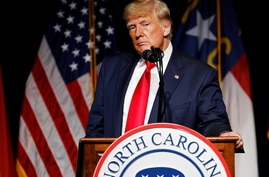 Former U.S. President Donald Trump pauses while speaking at the North Carolina GOP convention dinner in Greenville, North…