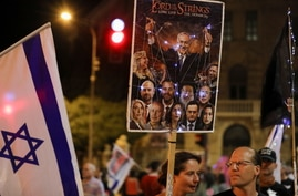 Protesters take part in a weekly demonstration against Israeli Prime Minister Benjamin Netanyahu, on potentially the last day…