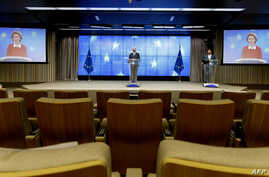 European Council President Charles Michel (C) addresses a media conference with European Commission President Ursula Von der…