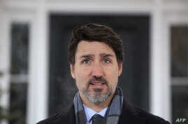 (FILES) In this file photo Canadian Prime Minister Justin Trudeau speaks during a news conference on COVID-19 situation in…