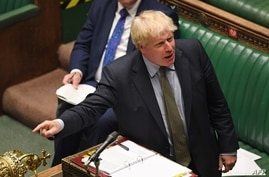 A handout photograph released by the UK Parliament shows Britain's Prime Minister Boris Johnson speaking during Prime Minister…