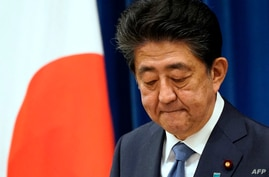 TOPSHOT - Japanese Prime Minister Shinzo Abe gestures during his press conference at the prime minister official residence in…