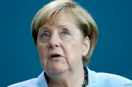German Chancellor Angela Merkel speaks during a joint press conference with Sweden's Prime Minister as part of a meeting in…