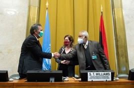 This handout photo released on October 23, 2020 by the United Nations Office in Geneva shows Head of the Libyan Arab Armed…