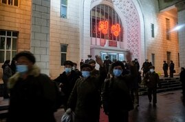 In a photo taken on November 20, 2020, returning elite party members exit the central Pyongyang Railway Station after arriving…