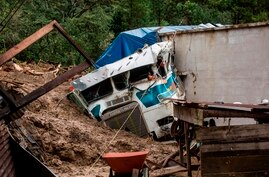 TOPSHOT - A truck is covered by mud at the side of a musdlide caused by the passage of Hurricane Eta in the village of Queja,…