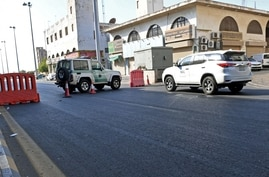 Saudi police close a street leading to a non-Muslim cemetery in the Saudi city of Jeddah where a bomb struck a World War I…