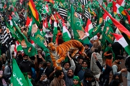 Supporters of Pakistan Democratic Movement (PDM) gather during an anti-government rally in Lahore on December 13, 2020. -  …