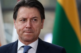 (FILES) In this file photo taken on February 21, 2020, Italy's Prime Minister Giuseppe Conte arrives for the second day of a…