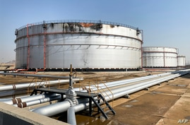 (FILES) This file photo taken on November 24, 2020, shows a view of a damaged silo at the Saudi Aramco oil facility in Saudi…
