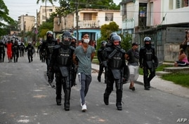 TOPSHOT - A man is arrested during a demonstration against the government of President Miguel Diaz-Canel in Arroyo Naranjo…