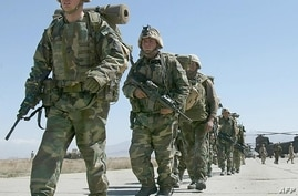 In this file photo taken on March 12, 2002, US soldiers arrive at Bagram Air Base, in Bagram. - All US and NATO troops have…