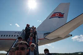 Passengers including foreign journalists invited for the 70th anniversary of North Korea's founding day, arrive on a plane at…