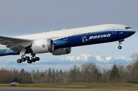 A Boeing 777X airplane takes off on its first flight, Saturday, Jan. 25, 2020, with the Olympic Mountains in the background, at…