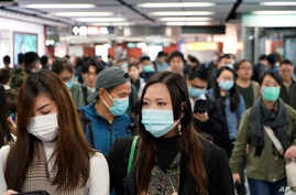 Passengers wear masks to prevent an outbreak of a new coronavirus in a subway station, in Hong Kong, Wednesday, Jan. 22, 2020…