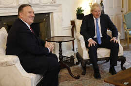 U.S. Secretary of State Mike Pompeo, left, meets with Britain's Prime Minister Boris Johnson at Downing Street in London,…